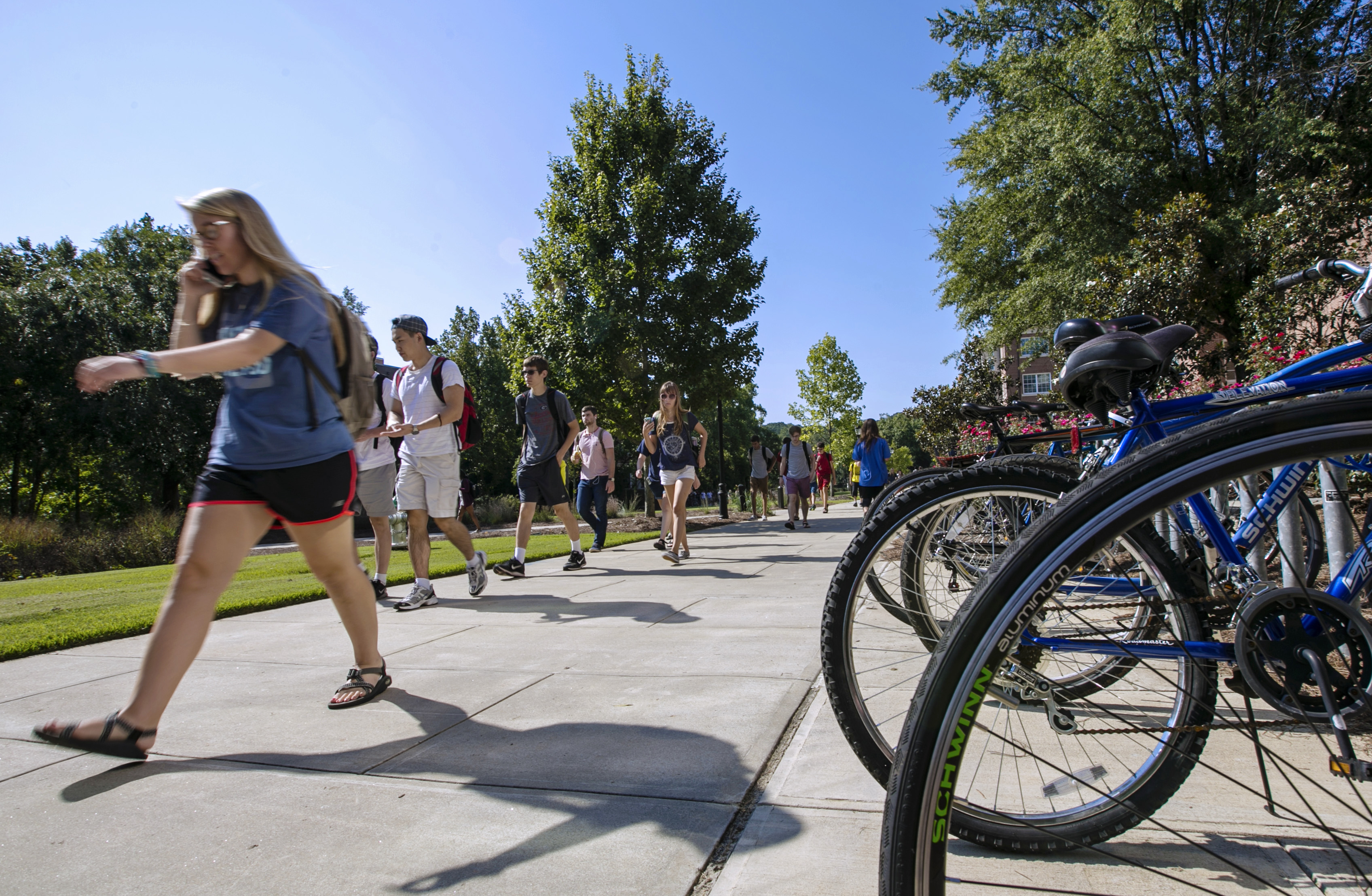"""""""Students walking to class"""" by UGA CAES/Extension is licensed under CC BY-NC 2.0."""