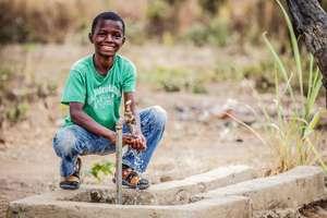 Kid enjoying access to water.