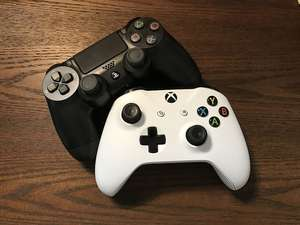 White Xbox and Sony PS4 Controllers on Brown Surface, Video Game.