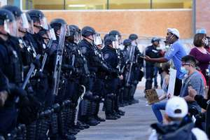 Protester facing off with Law Enforcement.